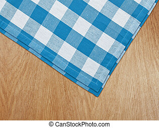 wooden kitchen table with blue gingham tablecloth