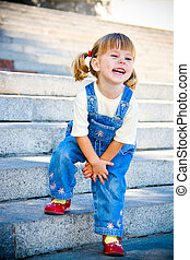 The happy child costs on steps