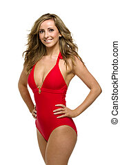 Woman in a red bathing suit - Beautiful woman stood with her...