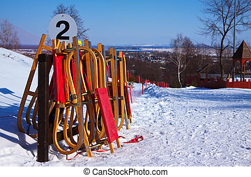 Wooden sleds in the ski resort