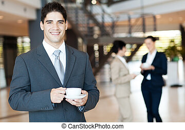 businessman having coffee break - handsome businessman...