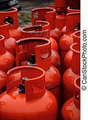 Row of red gas canisters - Rows of multiple red gas...