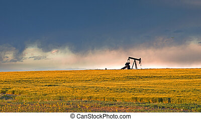 Pumpjack - A pumpjack silhoutte with dramatic sunset