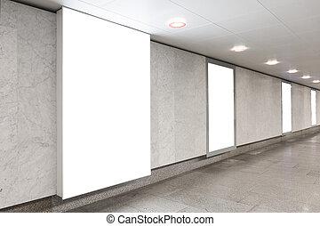Blank billboards in underground hall - Blank billboards...