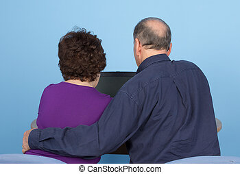 Elderly couple using a computer - A rear view of an elderly...