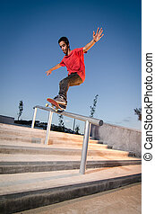Skateboarder on rail - Skateboarder doing a FS Feeble on...