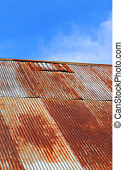 Patched Job - Old corrugated tinroof is rusting and patched....