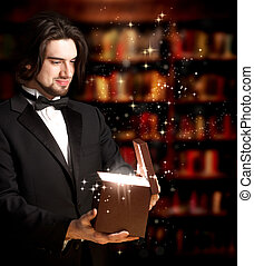 Man Opening a Gift Box - Happy Man with Bowtie Opening a...