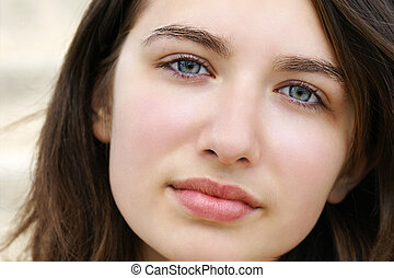 Serious young woman with blue eyes - Portrait of a beautiful...