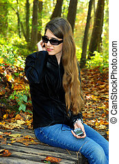 Alone with her tunes - Teenager, wearing black leather...