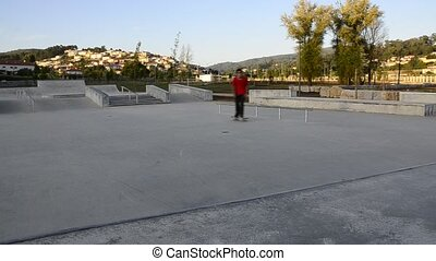 Skateboarder grinding a curb on a ramp at a public skate...