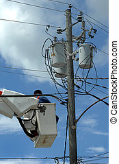 Wires Everywhere - Electric serviceman works on a...