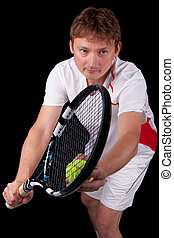 Portrait of a young male tennis player about to serve the...