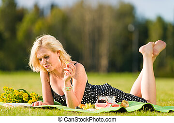 Free time - Lovely woman on picnic, she reading a book and...