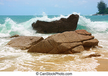 The waves breaking on a stony