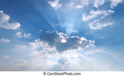 Sunbeam through the haze on blue sky: can be used as...