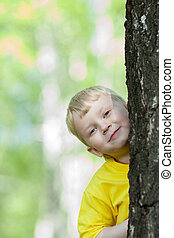 kid playing on the park tree outdoor