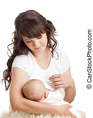 young mother breast feeding her infant - young mother breast...