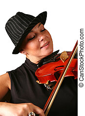 Violin - The woman in a hat playing its violin with a smile