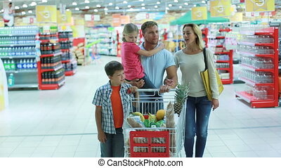 Usual shopping day - Parents and kids doing shopping...