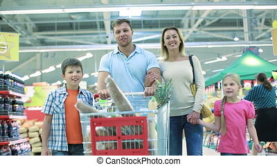 Perfect family - Smiling family of four enjoying shopping...