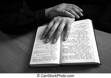 Open book - The male hand holds the open book