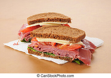 Corned beef sandwich on rye - A corned beef and swiss cheese...