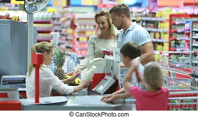 Mall service - Family paying for groceries at the checkout...