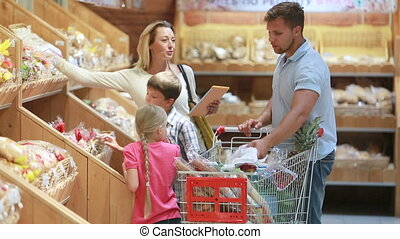 Fresh bakery - Shopping family choosing best bakery products...