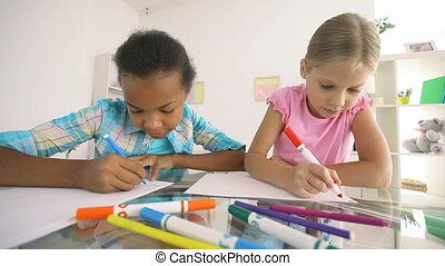 Homework together - Pretty classmates doing homework...
