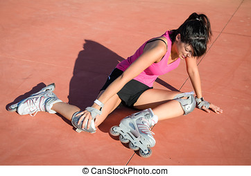 Roller skater injury - Female roller skater with protections...