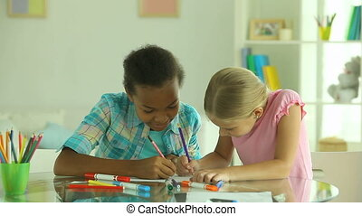 Team of artists - Excited girls drawing in pencil together