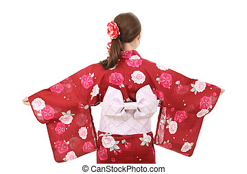 Young asian woman in clothes of kimono, back view