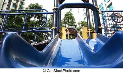 Pembroke Welsh Corgi sliding down a slide.