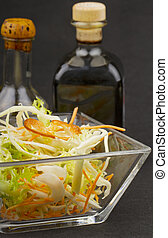 Salad - Close up of mixed salad with vinegar and oil on the...