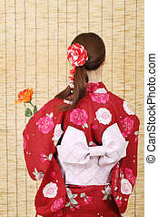 Back view of young asian woman in clothes of kimono with...