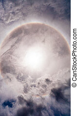sun halo in sky with cloud - Sun with circular rainbow sun...