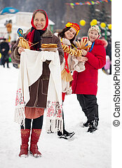 Women with pancake during Maslenitsa festival - Women in...
