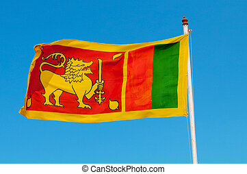 Sri Lanka flag on flagstaff. The lion represents the...