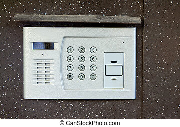 Close-up of building intercom in steel door