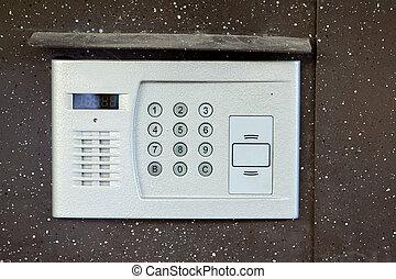 Close-up of building intercom in steel door