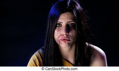 Depressed woman after being abused - Woman full of bruises...