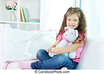 Happy child - Portrait of lovely girl with teddybear sitting...