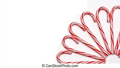 Arc - A partial arc of candy canes on a white background