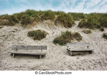 Two Wooden benches at the seaside in Henne, Denmark