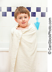 Bath time - Young boy at bath time in a towel