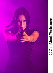 woman with a gun in the fog