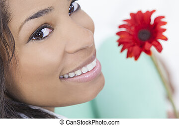 African American Woman With Red Flower