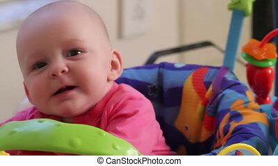 Happy Baby Girl in Bouncer