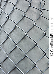 Metal grid overlaid to gray column - Metal grid overlaid on...